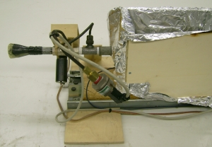 Fig. 5. Test stand with the pressure sensor in foreground and in the background the Laval nozzle with the remotely controlled valve.